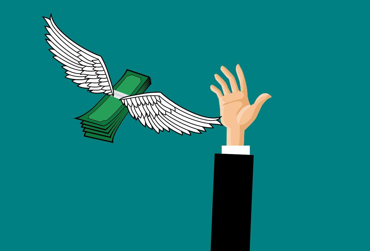 geld vliegen hand